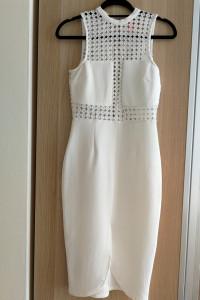 Biała kobieca elegancka sukienka midi