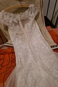 Suknia zrobiona w UK dluzszy tyl...