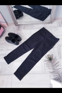 Materiałowe spodnie H&M...