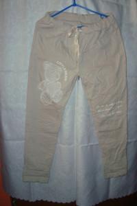 Nowe spodnie beżowe roz uniwersalny