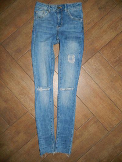 Spodnie Newer Denim spodnie jeans rurki dziury roz 32 34