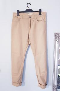 Męskie beżowe spodnie...