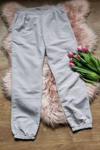 beżowe spodnie ze ściągaczami Calliope