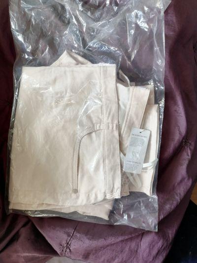 Spodnie Nowe spodnie perłowe delikatnie różowe rozmiar 50