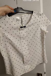 Sprzedania elegancka bluzke w kropki z kokardka...