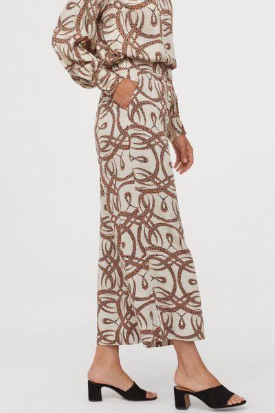 Spodnie Spodnie H&M x Richard Allan rozm 42 kuloty print