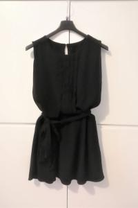 Czarna bluzka rozkloszowana H&M...