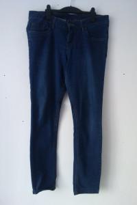 Niebieskie elastyczne jeansy rurki 46...