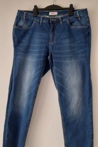 Niebieskie elastyczne jeansy do kostek 48...