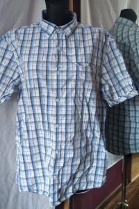 Biało błękitna koszula w kratkę L z kołnierzykiem i kieszeniami...