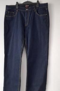 Granatowe męskie jeansy wysoki stan 48...