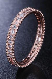 Nowy pierścionek obrączka cyrkonie białe różowe złoto róż złoty prosty modern celebrytka