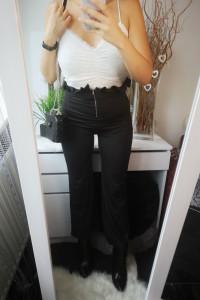 Spodnie damskie elastyczne z wysokim stanem czarne...
