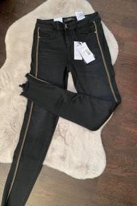 Czarne eleganckie spodnie damskie...