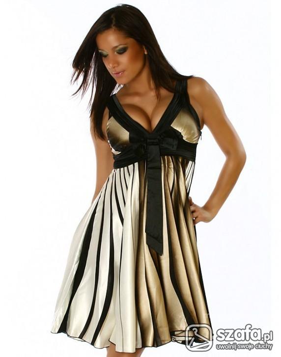 Śliczna sukienka w złote pasy