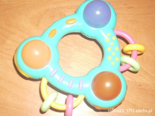 Zabawki super dzwiekowa swiecącxa grzechotka marks spencer