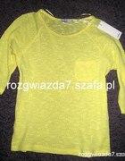 Żółty pastelowy sweterek Cubus z kieszonką