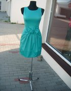 Miętowa sukienka z kokardą i zipem