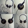 nowe słuchawki nauszne czarne ze złotymi dodatkami