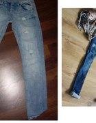 Jeansy z przetarciami L