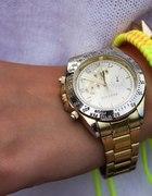 Złoty zegarek i bransoleta z ćwiekami...
