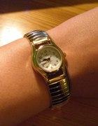 Złoty zegarek na rozciąganej bransolecie II...