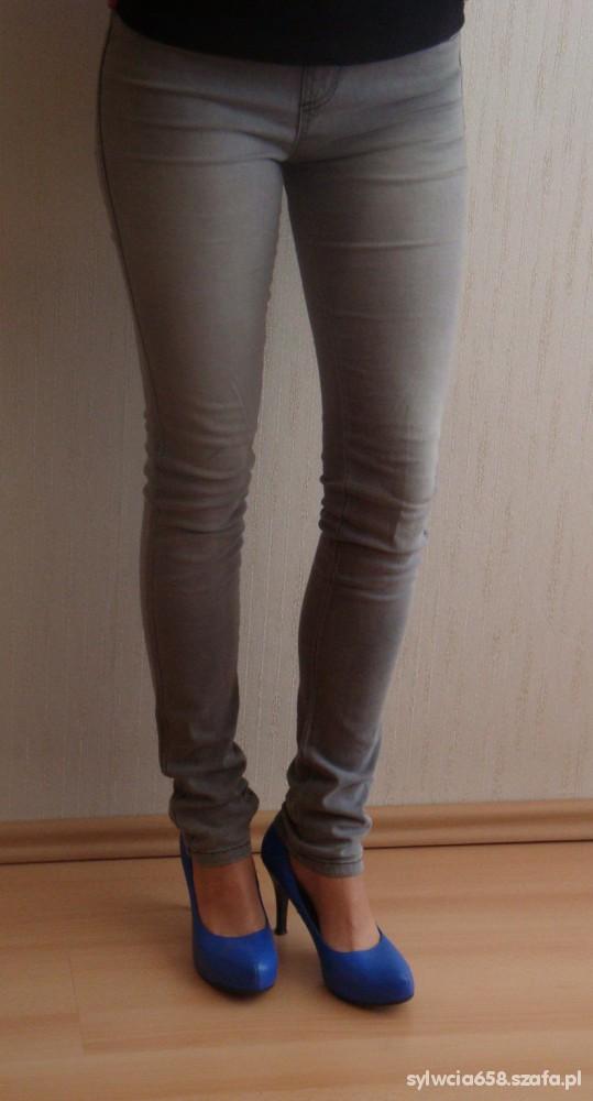 Spodnie Okazja spodnie rurki Orsay rozmiar 36