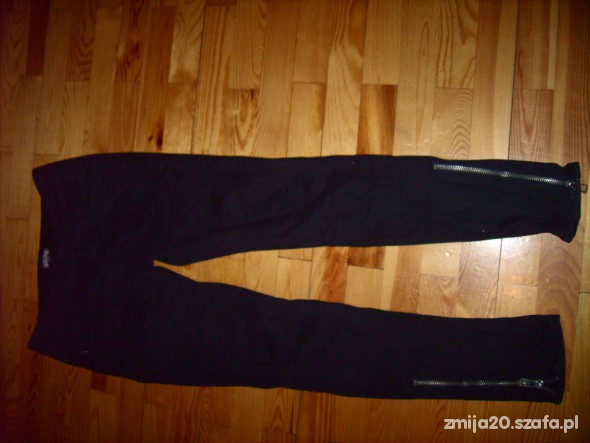 Spodnie z zamkami po bokach