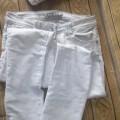 Szare spodnie z zameczkami