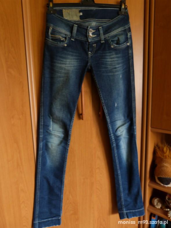 Spodnie BERSHKA RURKI PRZECIERANE 38 M GRANATOWE