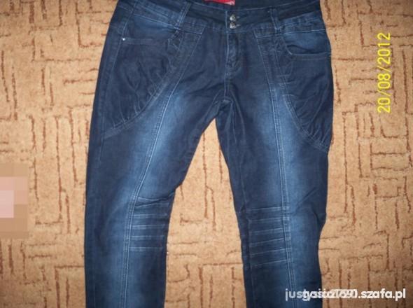 Spodnie wyszczuplajace rurki z przeszyciami xl