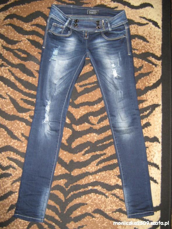 Spodnie RURKI GRANATOWE Z PRZETARCIAMI