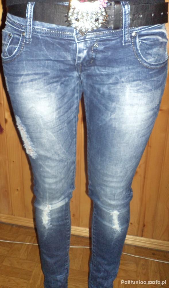 Spodnie spodnie z modnymi przetarciami