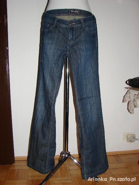 Spodnie Jeansy lekko rozszerzane biodrówki