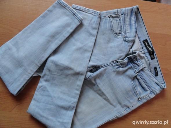 Spodnie colloseum 34 jasne jeansy