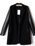 czarny płaszcz oversize skórzane rękawy