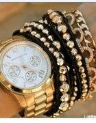złoty zegarek złote bransoletki