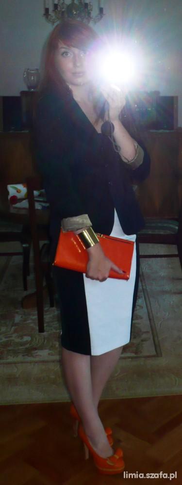 Klasyczna biel i czerń z pomarańczowym akcentem