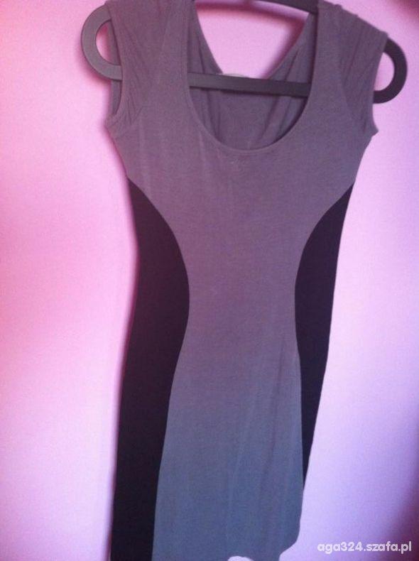 Suknie i sukienki skromna z wyszczuplającymi czarnymi wstawkami