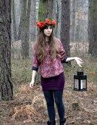 Garland on her head lantern in her hand