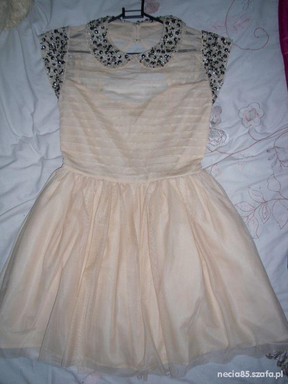Wieczorowe Cudeńko rozkloszowana sukienka