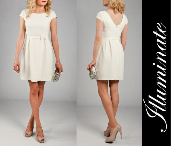 Rozkloszowana sukienka z kokardką L XL kolory