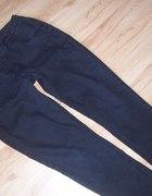 szare tregginsy spodnie jeansy 44 46