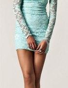 Miętowa koronkowa sukienka z kokardką