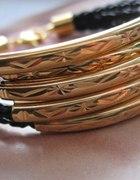 Czarna bransoletka z rzemienia złote rurki