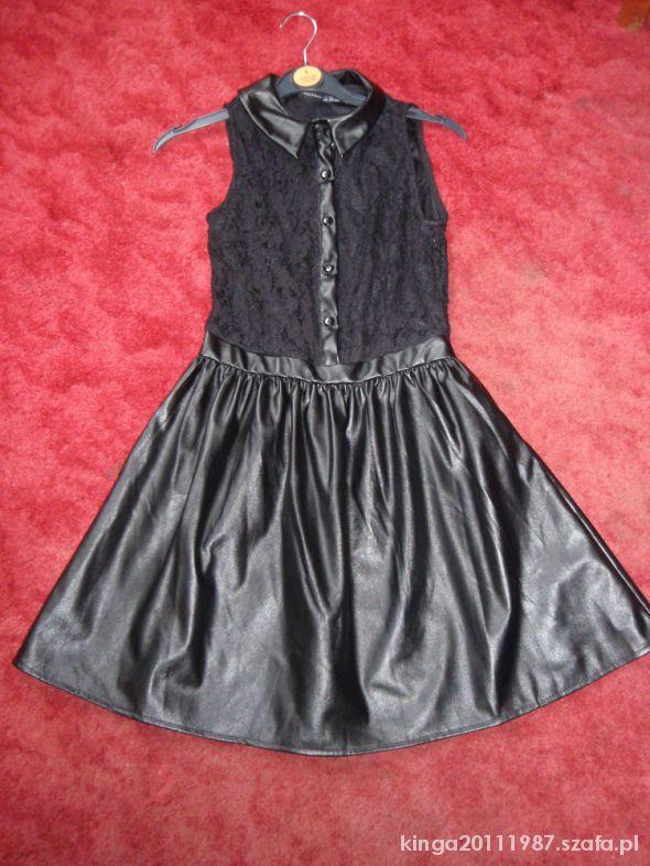 Koronkowo skórzana sukienka rozkloszowana