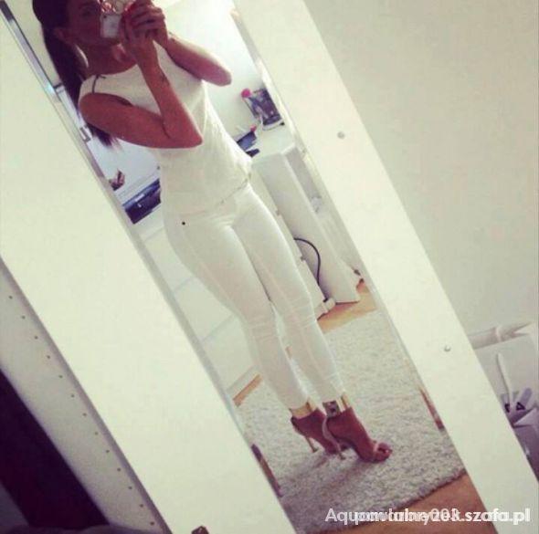 Eleganckie cała biała stylizacja