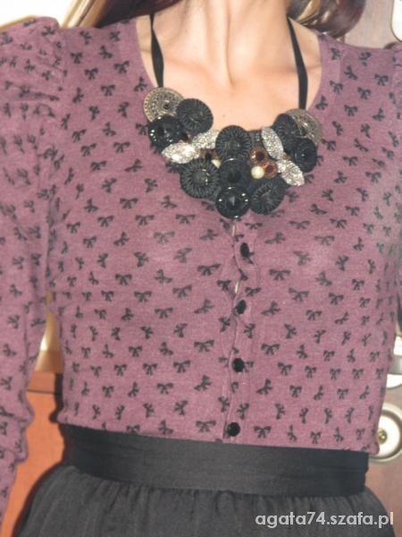 Eleganckie kokardkowy sweterek