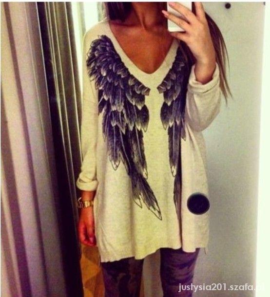 KappAhl sweter z pięknym motywem...