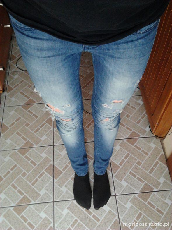 spodnie rurki przetarcia dziury wytarcia S jeans